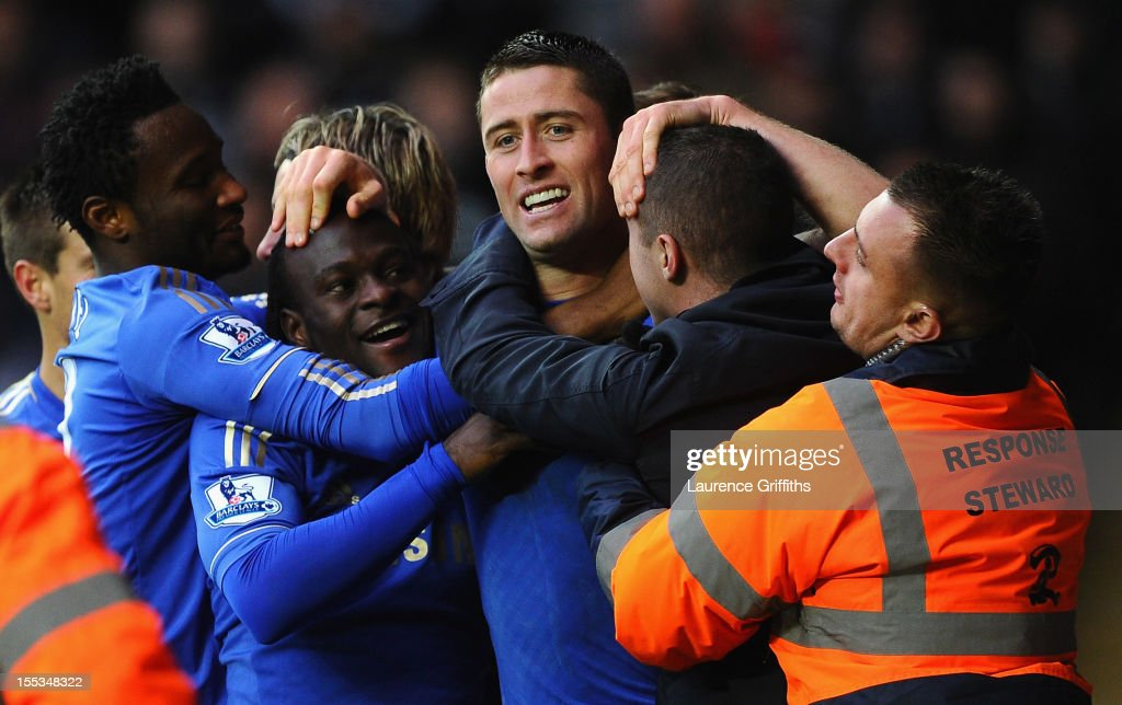 Victor Moses of Chelsea is congratulated by Gary Cahill on scoring the opening goal during the Barclays Premier League match between Swansea City and...