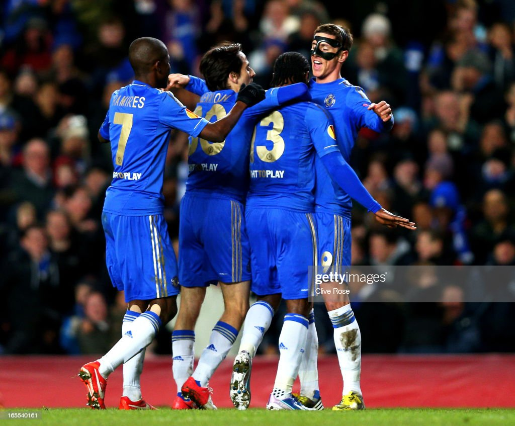 <a gi-track='captionPersonalityLinkClicked' href=/galleries/search?phrase=Victor+Moses&family=editorial&specificpeople=2649383 ng-click='$event.stopPropagation()'>Victor Moses</a> #3 of Chelsea is congratulated teammates Ramires (L), <a gi-track='captionPersonalityLinkClicked' href=/galleries/search?phrase=Yossi+Benayoun&family=editorial&specificpeople=635033 ng-click='$event.stopPropagation()'>Yossi Benayoun</a> (2nd L) and <a gi-track='captionPersonalityLinkClicked' href=/galleries/search?phrase=Fernando+Torres&family=editorial&specificpeople=194755 ng-click='$event.stopPropagation()'>Fernando Torres</a> (R)after scoring his team's second goal during the UEFA Europa League quarter final first leg match between Chelsea and FC Rubin Kazan at Stamford Bridge on April 4, 2013 in London, England.