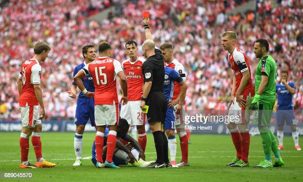 Victor Moses of Chelsea is shown a red card by referee Anthony Taylor during the Emirates FA Cup Final between Arsenal and Chelsea at Wembley Stadium...