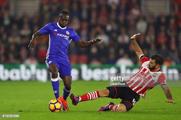 Victor Moses of Chelsea is tackled by Charlie Austin of Southampton during the Premier League match between Southampton and Chelsea at St Mary's...