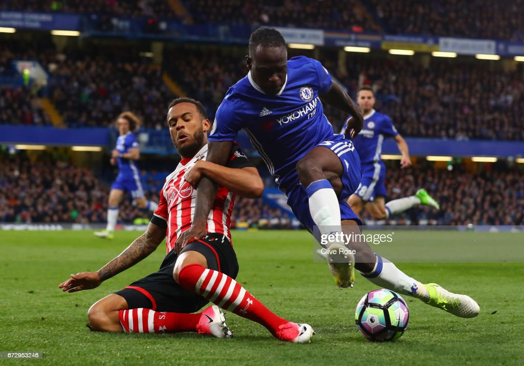 Victor Moses of Chelsea is tackled by Ryan Bertrand of Southampton during the Premier League match between Chelsea and Southampton at Stamford Bridge on April 25, 2017 in London, England.