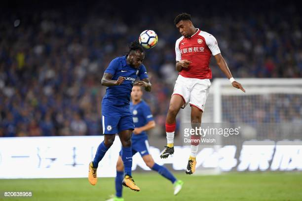 Victor Moses of Chelsea jumps for the ball with Alex Iwobi of Arsenal during the PreSeason Friendly match between Arsenal FC and Chelsea FC at Birds...