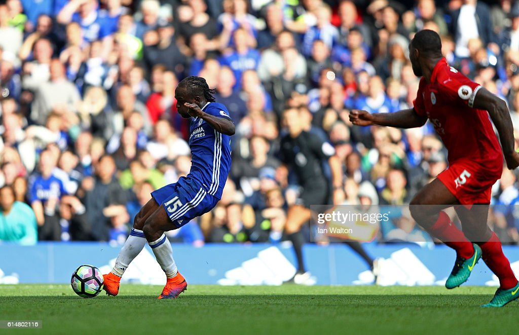 Victor Moses of Chelsea (L) scores his sides third goal during the Premier League match between Chelsea and Leicester City at Stamford Bridge on October 15, 2016 in London, England.
