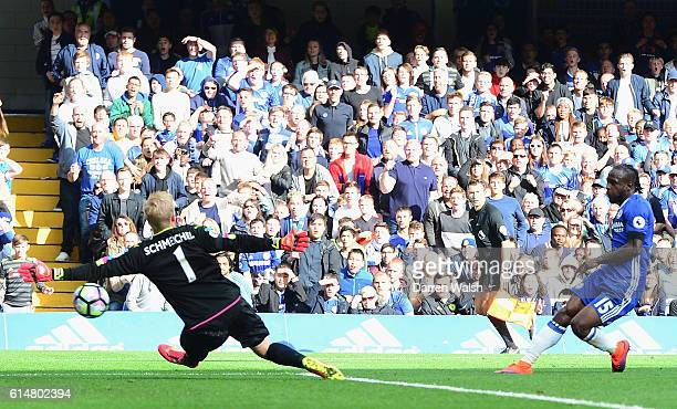 Victor Moses of Chelsea scores his sides third goal past Kasper Schmeichel of Leicester City during the Premier League match between Chelsea and...
