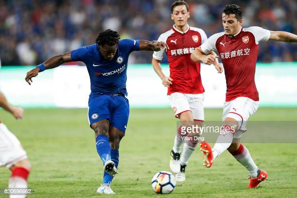 Victor Moses of Chelsea takes a shot againt Granit Xhaka of Arsenal during the PreSeason Friendly match between Arsenal FC and Chelsea FC at Birds...
