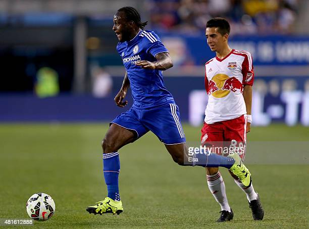 Victor Moses of Chelsea takes the ball as Daniel Bedoya of the New York Red Bulls defends during the International Champions Cup at Red Bull Arena on...