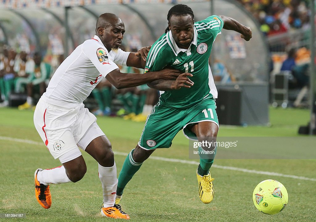 Victor Moses of Nigeria is tackled by Mohamed Koffi of Burkina Faso during the 2013 Africa Cup of Nations Final match between Nigeria and Burkina at FNB Stadium on February 10, 2013 in Johannesburg, South Africa.