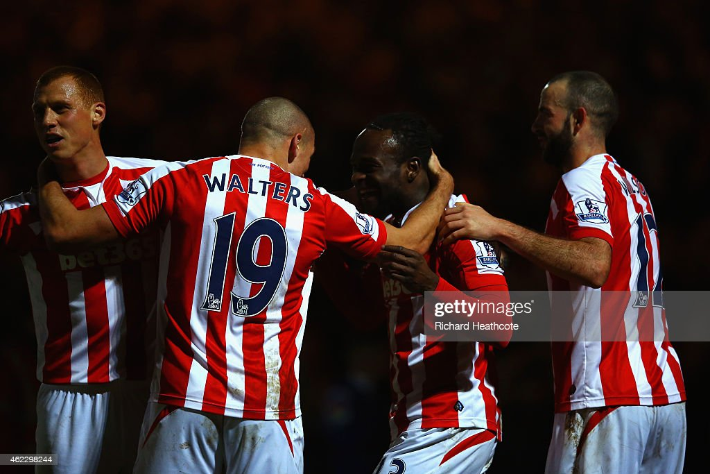 Victor Moses of Stoke City celebrates scoring their third goal with team mates during the FA Cup fourth round match between Rochdale and Stoke City...