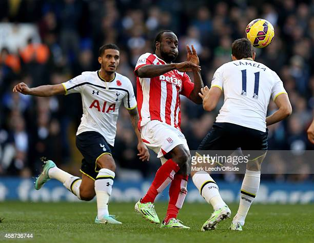 Victor Moses of Stoke City in action with Kyle Naughton and Erik Lamela of Tottenham Hotspur during the Barclays Premier League match between...