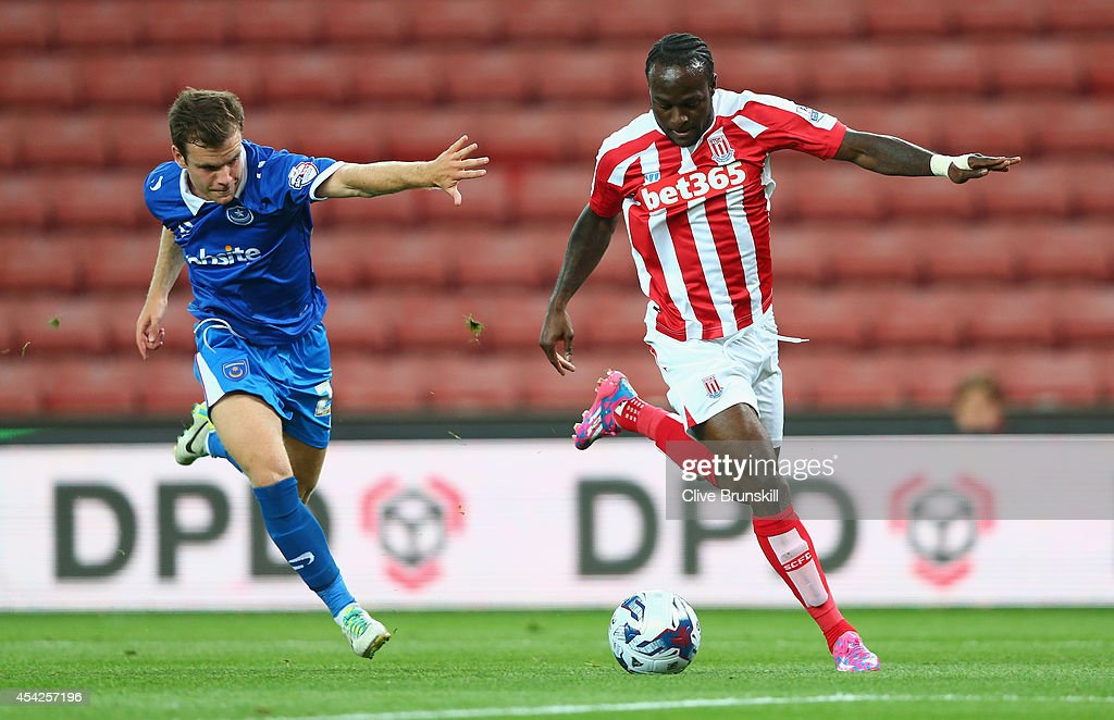 Victor Moses of Stoke City in action with Nick Awford of Portsmouth during the Capital One Cup Second Round match between Stoke City and Portsmouth at Britannia Stadium on August 27, 2014 in Stoke on Trent, England.