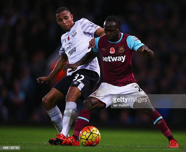 Victor Moses of West Ham United and Brendan Galloway of Everton compete for the ball during the Barclays Premier League match between West Ham United...