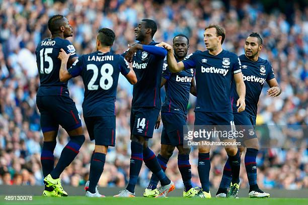 Victor Moses of West Ham United celebrates scoring the opening goal with his team mates during the Barclays Premier League match between Manchester...