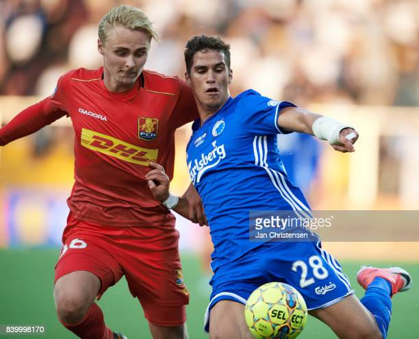 Victor Nelsson of FC Nordsjalland and Pieros Sotiriou of FC Copenhagen compete for the ball during the Danish Alka Superliga match between FC...