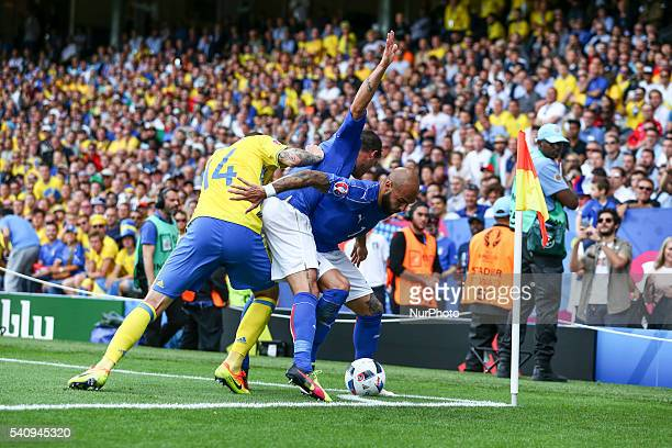 Victor Nilsson Lindelof of Sweden fight for the ball with Stefano Sturaro and Simone Zaza of Italy during the UEFA EURO 2016 Group E match between...
