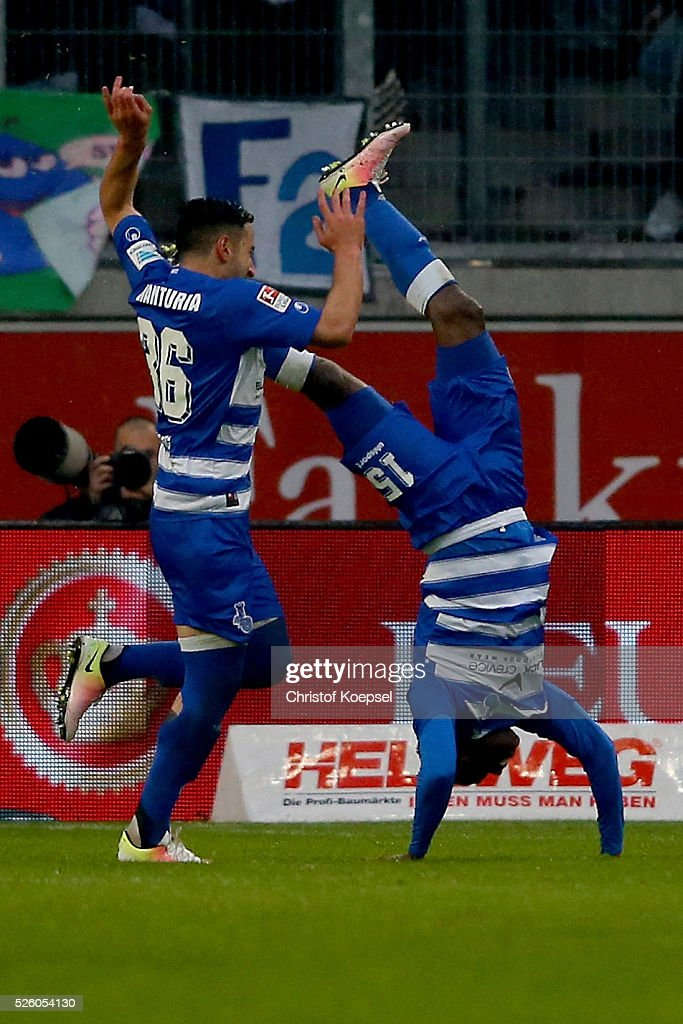 <a gi-track='captionPersonalityLinkClicked' href=/galleries/search?phrase=Victor+Obinna&family=editorial&specificpeople=2218719 ng-click='$event.stopPropagation()'>Victor Obinna</a> of Duisburg (R) celebrates the second goal with Giorigi Chanturia of Duisburg (L) during the 2. Bundesliga match between MSV Duisburg and Fortuna Duesseldorf at Schauinsland-Reisen-Arena on April 29, 2016 in Duisburg, Germany.