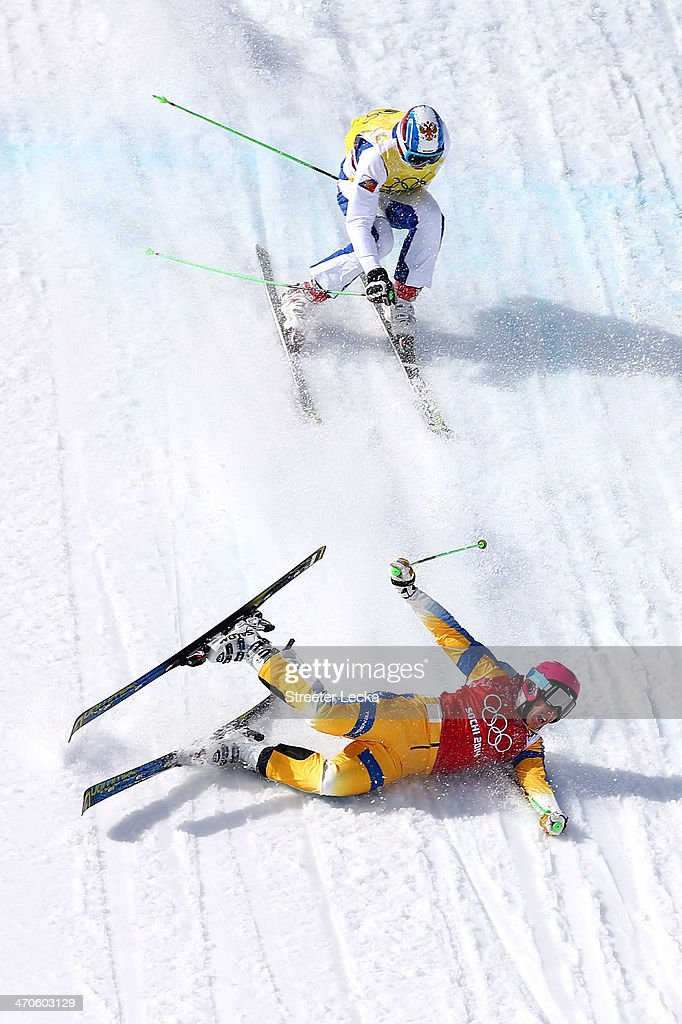 Victor Oehling Norberg of Sweden crashes to the snow followed by <a gi-track='captionPersonalityLinkClicked' href=/galleries/search?phrase=Egor+Korotkov&family=editorial&specificpeople=6703450 ng-click='$event.stopPropagation()'>Egor Korotkov</a> of Russia during the Freestyle Skiing Men's Ski Cross Quarter Finals on day 13 of the 2014 Sochi Winter Olympic at Rosa Khutor Extreme Park on February 20, 2014 in Sochi, Russia.