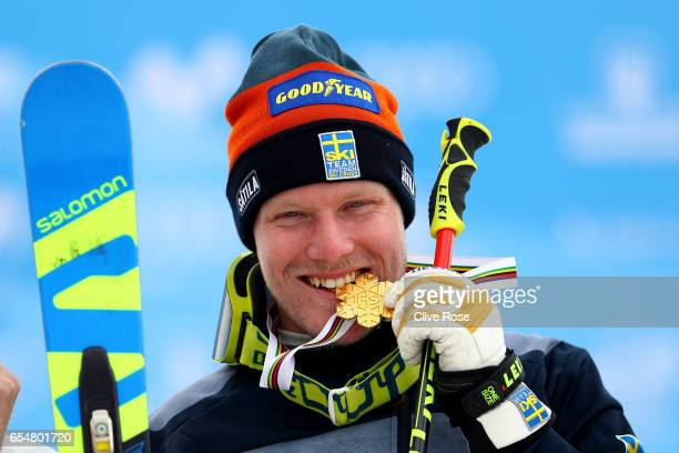 Victor Oehling Norberg of Sweden poses with his Gold medal on the podium after winning the Men's Ski Cross Final on day eleven of the FIS Freestyle...