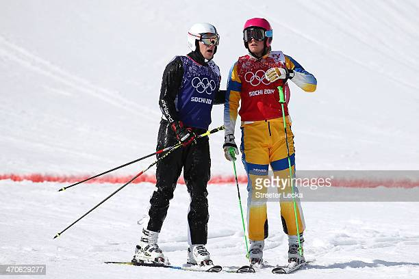 Victor Oehling Norberg of Sweden talks to Jouni Pellinen of Finland during the Freestyle Skiing Men's Ski Cross Quarter Finals on day 13 of the 2014...