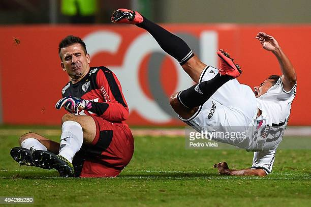 Victor of Atletico MG and Cesinha of Ponte Preta battle for the ball during a match between Atletico MG and Ponte Preta as part of Brasileirao Series...