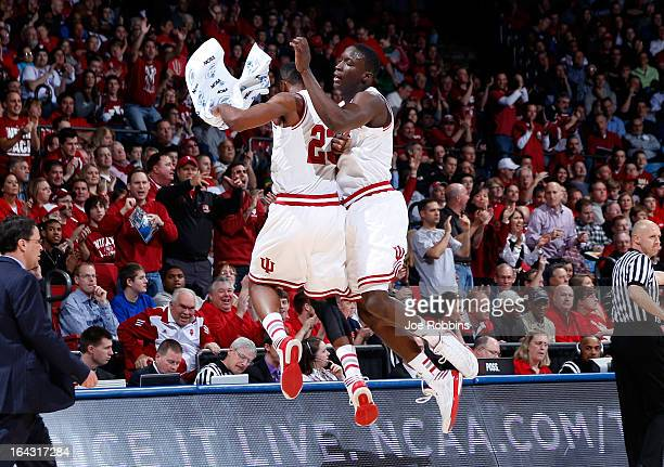 Victor Oladipo and Remy Abell of the Indiana Hoosiers celebrate a three point basket by Oladipo in the first half against the James Madison Dukes...