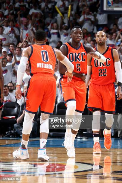 Victor Oladipo and Russell Westbrook of the Oklahoma City Thunder high five each other during the game against the Houston Rockets in Game Four...
