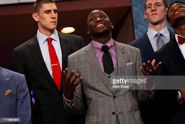 Victor Oladipo of Indiana drafted overall in the first round by the Orlando Magic looks up prior to the start if the first round during the 2013 NBA...