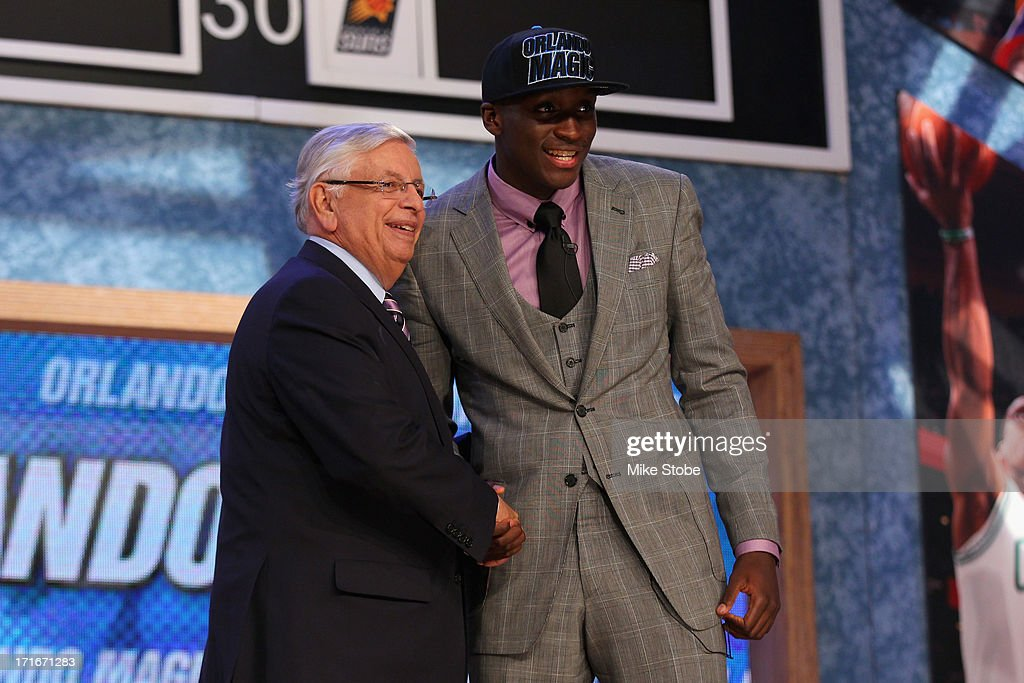 Victor Oladipo of Indiana poses for a photo with NBA Commissioner David Stern after Oladipo was drafted overall in the first round by the Orlando...