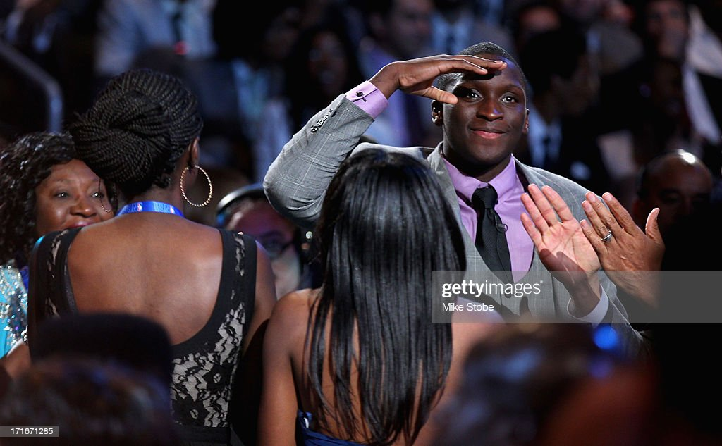 <a gi-track='captionPersonalityLinkClicked' href=/galleries/search?phrase=Victor+Oladipo&family=editorial&specificpeople=6681560 ng-click='$event.stopPropagation()'>Victor Oladipo</a> of Indiana reacts after Oladipo was drafted #2 overall in the first round by the Orlando Magic during the 2013 NBA Draft at Barclays Center on June 27, 2013 in in the Brooklyn Borough of New York City.