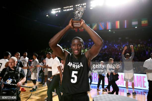Victor Oladipo of Team Africa receives the MVP trophy after the game against Team World in the 2017 Africa Game as part of the Basketball Without...