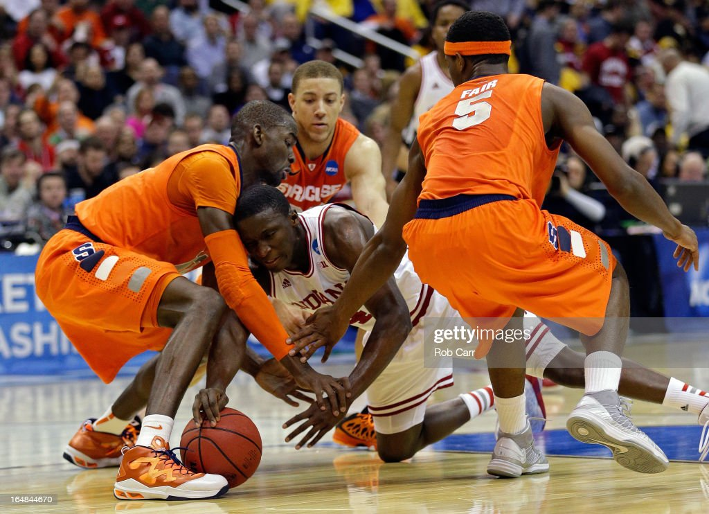 <a gi-track='captionPersonalityLinkClicked' href=/galleries/search?phrase=Victor+Oladipo&family=editorial&specificpeople=6681560 ng-click='$event.stopPropagation()'>Victor Oladipo</a> #4 of the Indiana Hoosiers fights for the loose ball against Baye Keita #12, <a gi-track='captionPersonalityLinkClicked' href=/galleries/search?phrase=Brandon+Triche&family=editorial&specificpeople=6516120 ng-click='$event.stopPropagation()'>Brandon Triche</a> #20 and <a gi-track='captionPersonalityLinkClicked' href=/galleries/search?phrase=C.J.+Fair&family=editorial&specificpeople=7366451 ng-click='$event.stopPropagation()'>C.J. Fair</a> #5 of the Syracuse Orange during the East Regional Round of the 2013 NCAA Men's Basketball Tournament at Verizon Center on March 28, 2013 in Washington, DC.