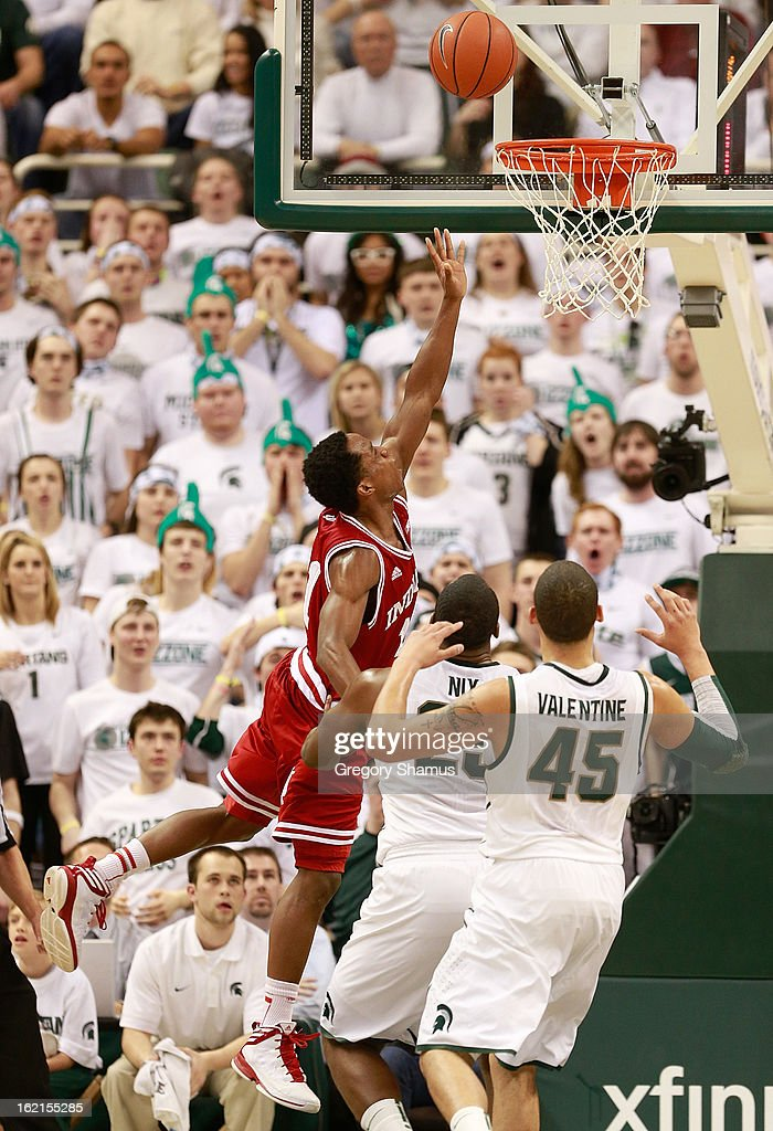 <a gi-track='captionPersonalityLinkClicked' href=/galleries/search?phrase=Victor+Oladipo&family=editorial&specificpeople=6681560 ng-click='$event.stopPropagation()'>Victor Oladipo</a> #4 of the Indiana Hoosiers gets to the basket for a second half layup past Derrick Nix #25 of the Michigan State Spartans at the Jack T. Breslin Student Events Center on February 19, 2013 in East Lansing, Michigan. Indiana won the game 72-68.