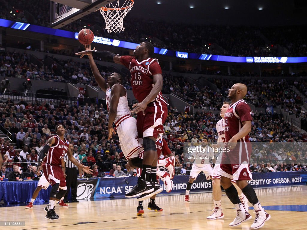 Victor Oladipo #4 of the Indiana Hoosiers goes up for a shot against Tshilidzi Nephawe #15 of the New Mexico State Aggies in the first half in the second round of the 2012 NCAA men's basketball tournament at Rose Garden Arena on March 15, 2012 in Portland, Oregon.