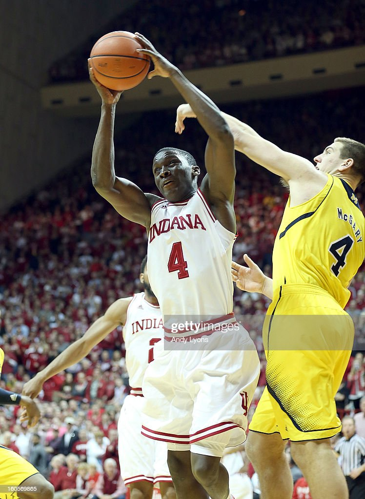 <a gi-track='captionPersonalityLinkClicked' href=/galleries/search?phrase=Victor+Oladipo&family=editorial&specificpeople=6681560 ng-click='$event.stopPropagation()'>Victor Oladipo</a> #4 of the Indiana Hoosiers grabs a rebound during the game against the Michigan Wolverines at Assembly Hall on February 2, 2013 in Bloomington, Indiana.