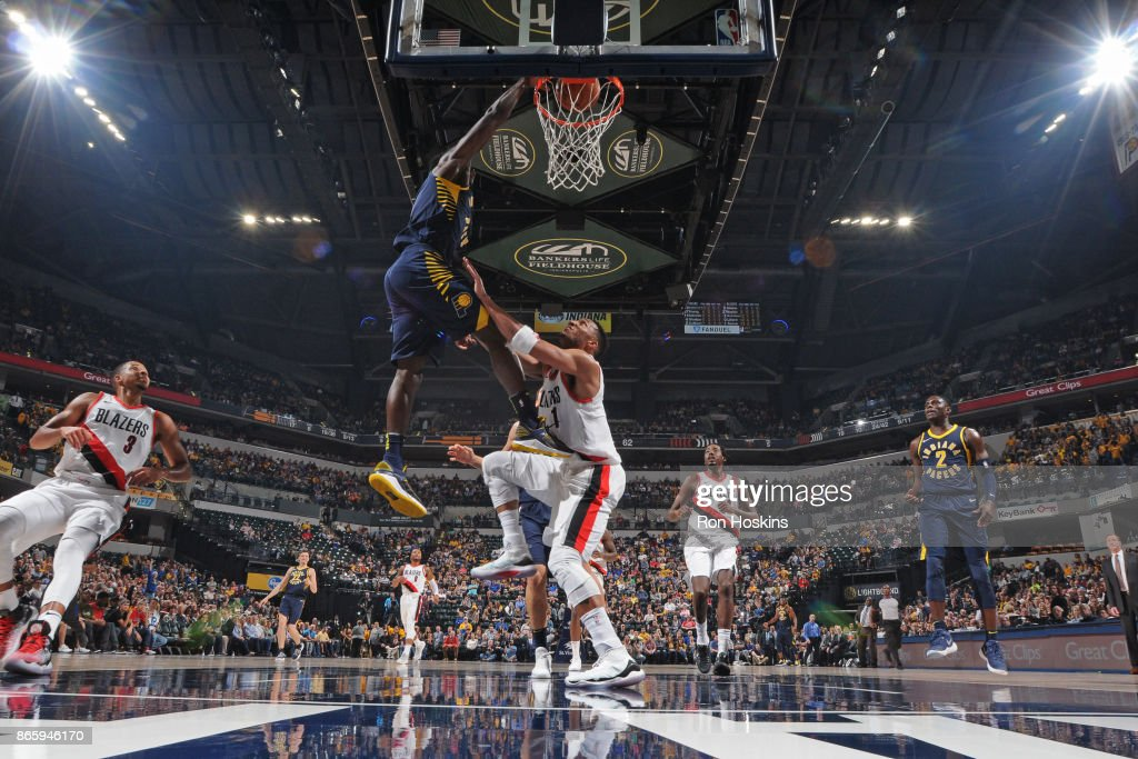 Victor Oladipo #4 of the Indiana Pacers dunks the ball against Evan Turner #1 of the Portland Trail Blazers on October 20, 2017 at Bankers Life Fieldhouse in Indianapolis, Indiana.