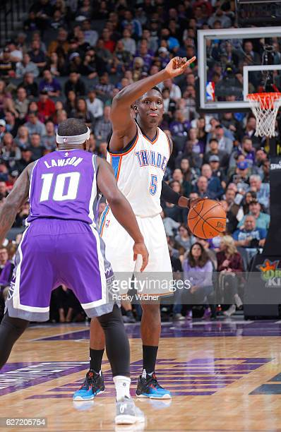 Victor Oladipo of the Oklahoma City Thunder handles the ball against Ty Lawson of the Sacramento Kings on November 23 2016 at Golden 1 Center in...