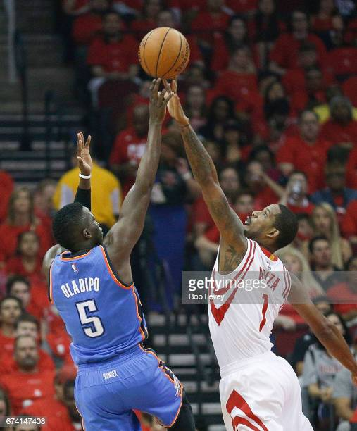 Victor Oladipo of the Oklahoma City Thunder has his shot blocked by Trevor Ariza of the Houston Rockets during Game Five of the Western Conference...