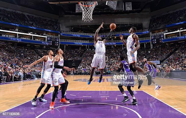 Victor Oladipo of the Oklahoma City Thunder rebounds against the Sacramento Kings on November 23 2016 at Golden 1 Center in Sacramento California...