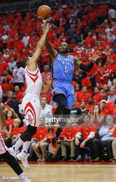 Victor Oladipo of the Oklahoma City Thunder shoots over Eric Gordon of the Houston Rockets during Game Five of the Western Conference Quarterfinals...