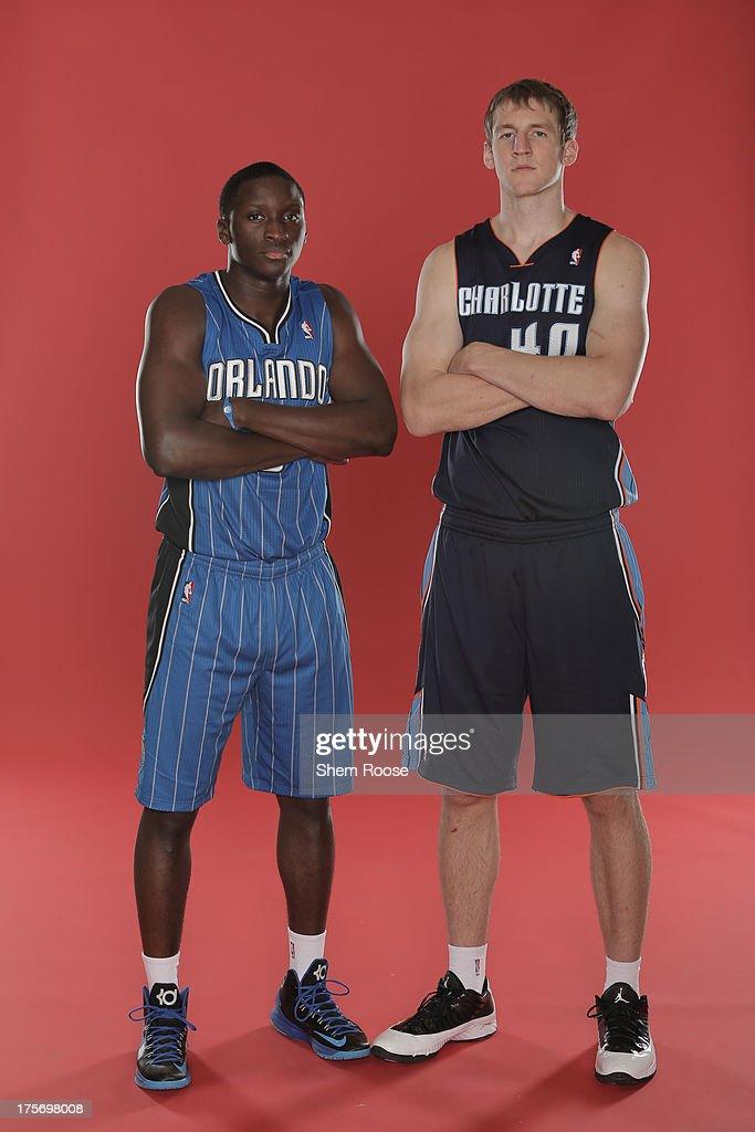 Victor Oladipo #5 of the Orlando Magic and Cody Zeller #40 of the Charlotte Bobcats poses for a portrait during the 2013 NBA rookie photo shoot on August 6, 2013 at the Madison Square Garden Training Facility in Tarrytown, New York.