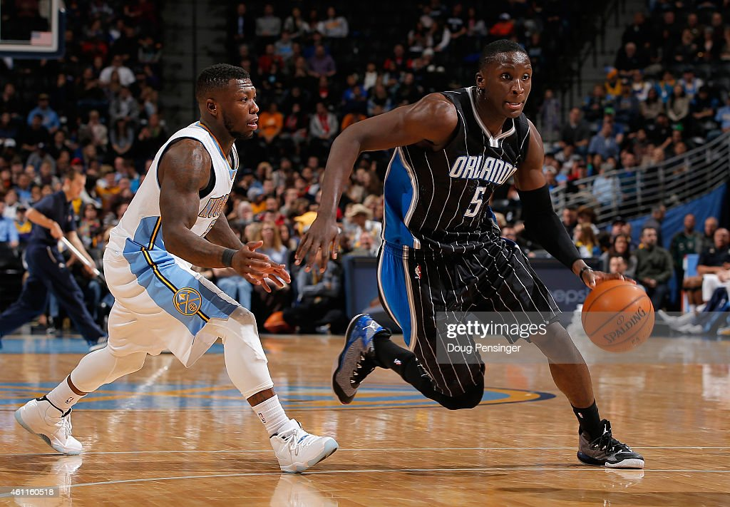 Victor Oladipo of the Orlando Magic controls the ball against Nate Robinson of the Denver Nuggets at Pepsi Center on January 7 2015 in Denver...