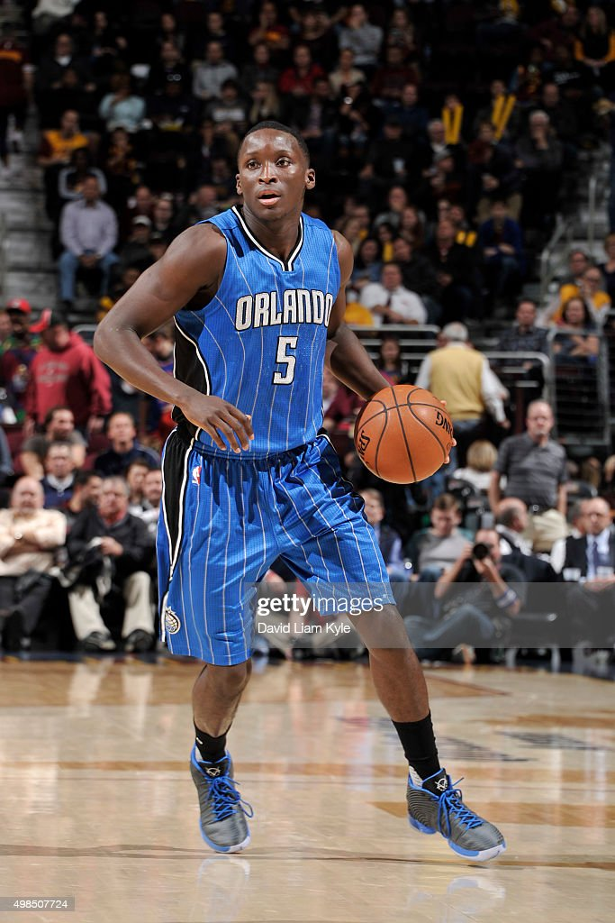 Victor Oladipo of the Orlando Magic dribbles the ball against the Cleveland Cavaliers on November 23 2015 at Quicken Loans Arena in Cleveland Ohio...