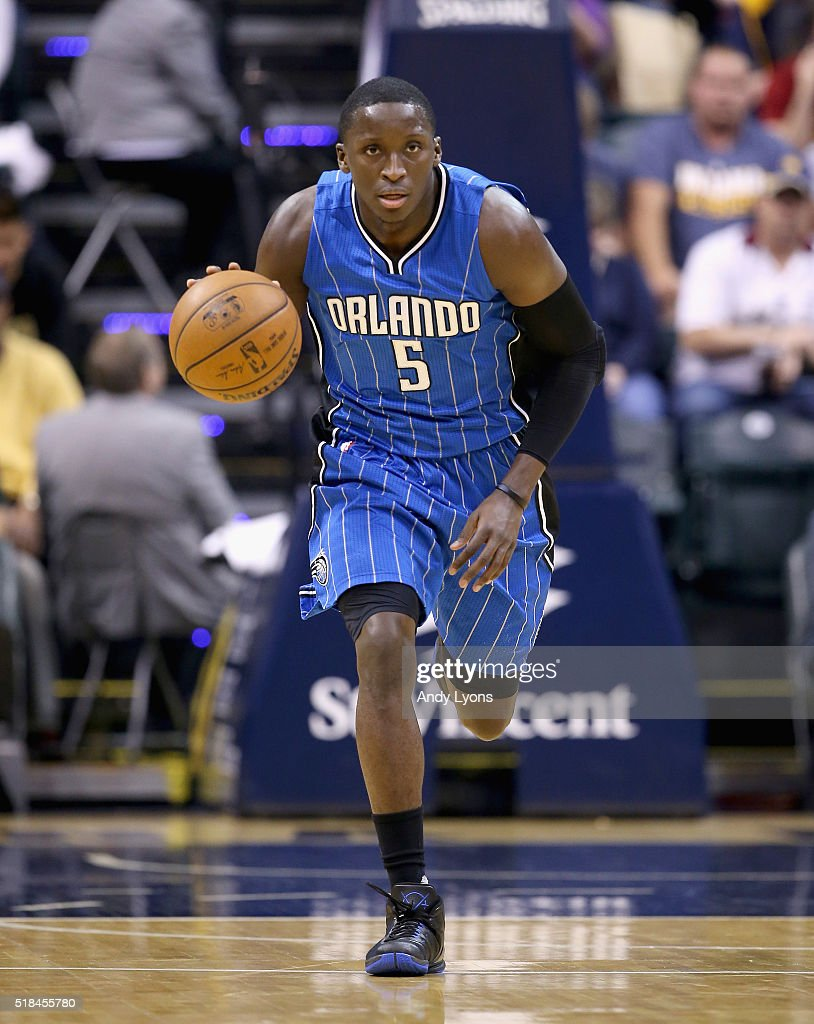 Victor Oladipo of the Orlando Magic dribbles the ball during the game against the Indiana Pacers at Bankers Life Fieldhouse on March 31 2016 in...