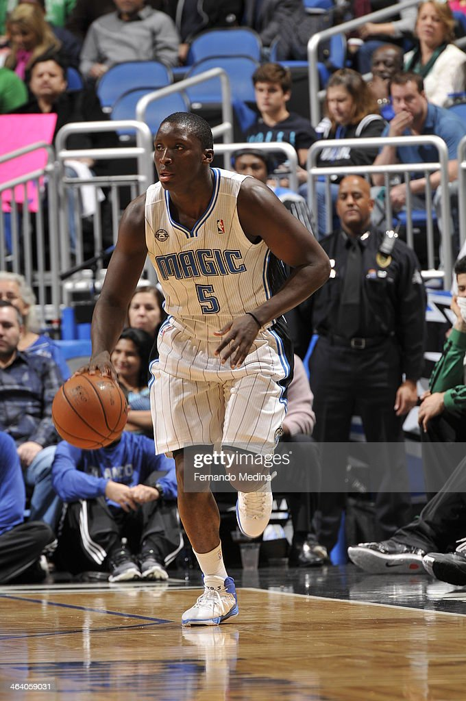 <a gi-track='captionPersonalityLinkClicked' href=/galleries/search?phrase=Victor+Oladipo&family=editorial&specificpeople=6681560 ng-click='$event.stopPropagation()'>Victor Oladipo</a> #5 of the Orlando Magic dribbles up the court against the Boston Celtics during the game on January 19, 2014 at Amway Center in Orlando, Florida.