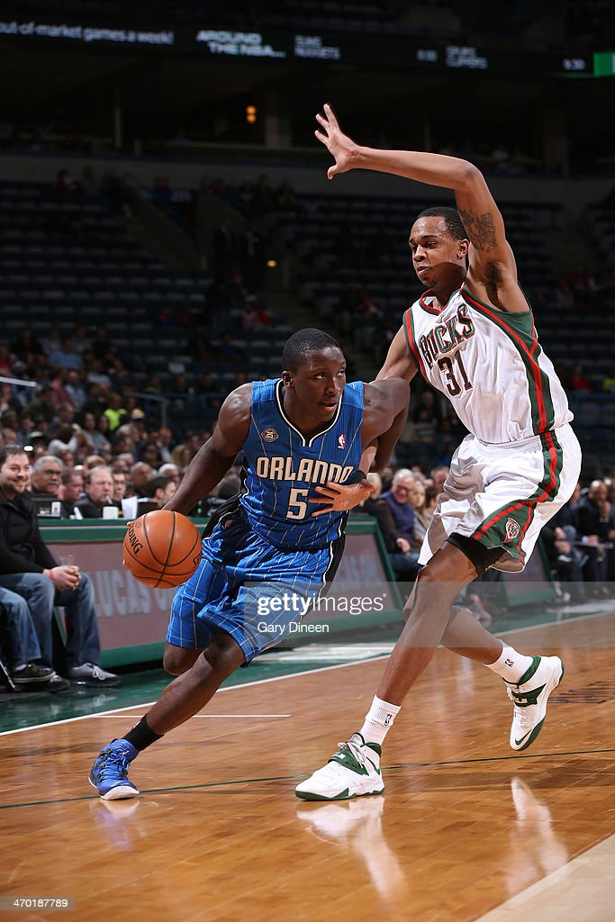Victor Oladipo #5 of the Orlando Magic drives to the basket against John Henson #31 of the Milwaukee Bucks on February 18, 2014 at the BMO Harris Bradley Center in Milwaukee, Wisconsin.