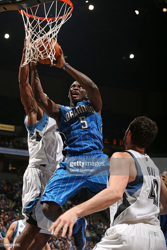 <a gi-track='captionPersonalityLinkClicked' href=/galleries/search?phrase=Victor+Oladipo&family=editorial&specificpeople=6681560 ng-click='$event.stopPropagation()'>Victor Oladipo</a> #5 of the Orlando Magic drives to the basket against the Minnesota Timberwolves during the season and home opening game on October 30, 2013 at Target Center in Minneapolis, Minnesota.