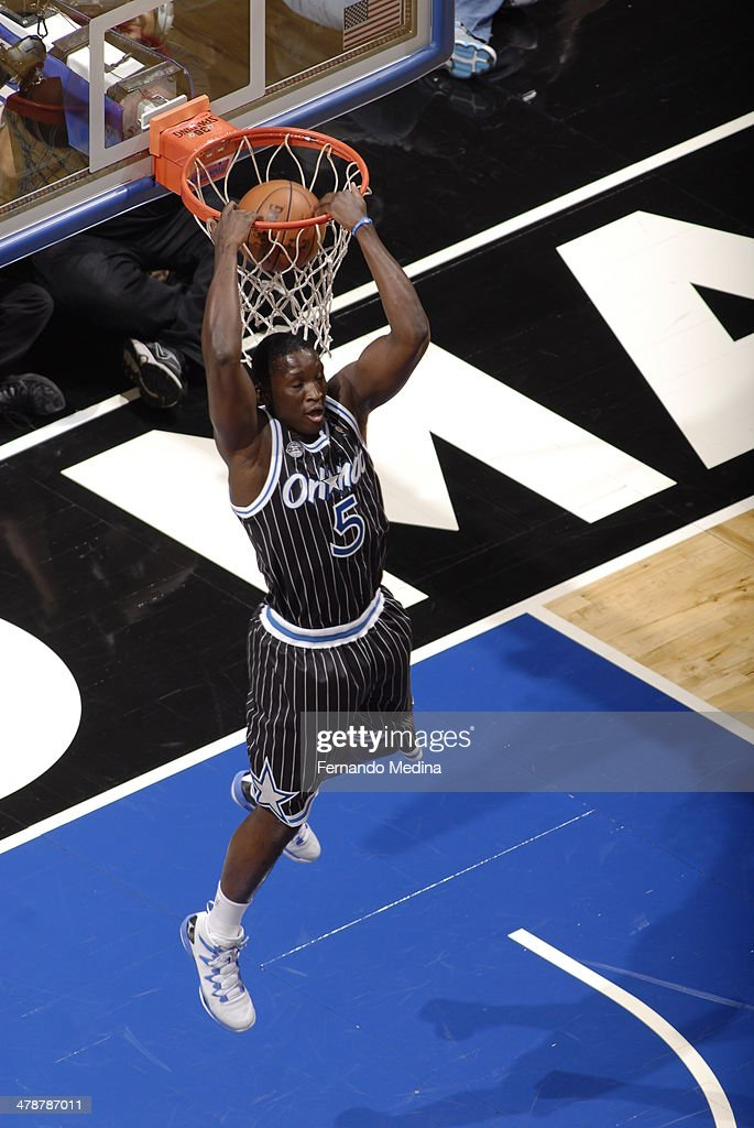 Victor Oladipo of the Orlando Magic dunks the ball against the Washington Wizards during the game on March 14 2014 at Amway Center in Orlando Florida...
