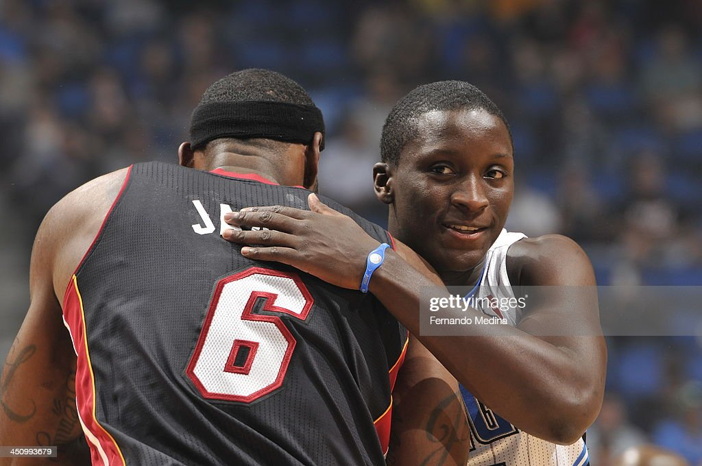Victor Oladipo #5 of the Orlando Magic greets LeBron James #6 of the Miami Heat during the game on November 20, 2013 at Amway Center in Orlando, Florida.