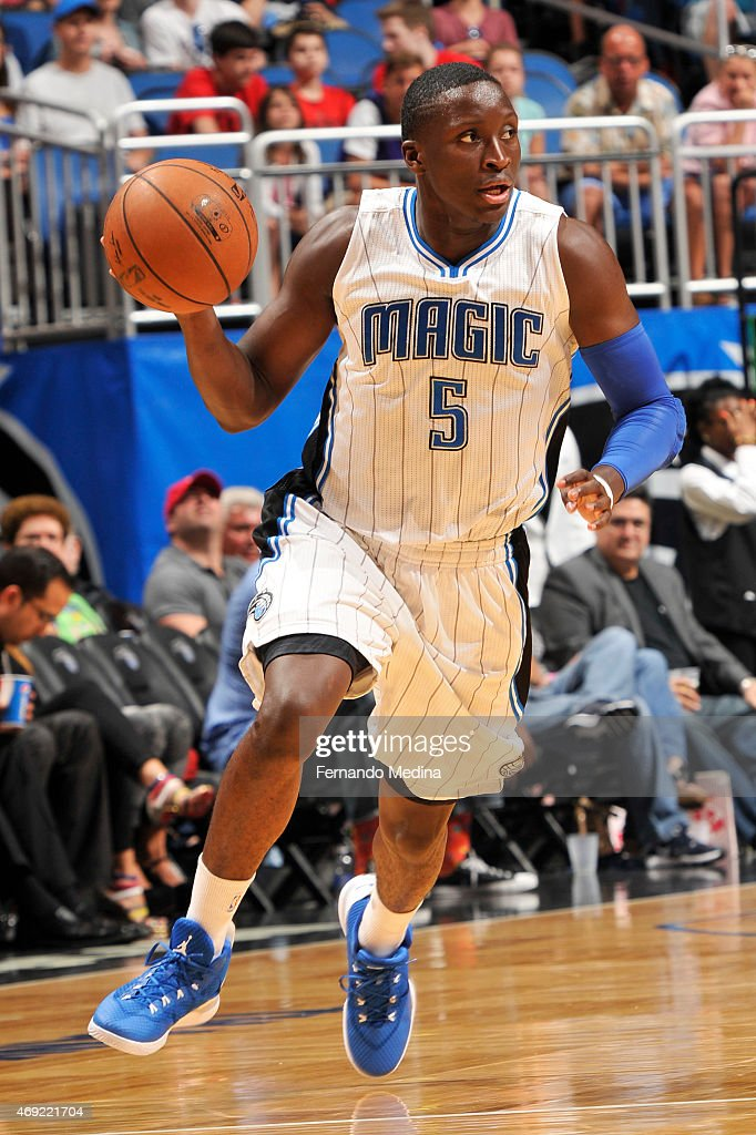 Victor Oladipo of the Orlando Magic handles the ball against the Toronto Raptors on April 10 2015 at Amway Center in Orlando Florida NOTE TO USER...