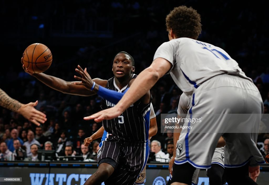 Victor Oladipo (5) of the Orlando Magic in action against Brook Lopez (11) of the Brooklyn Nets during an NBA basketball game at the Barclays Center in the Brooklyn borough of New York City on April 15, 2015.