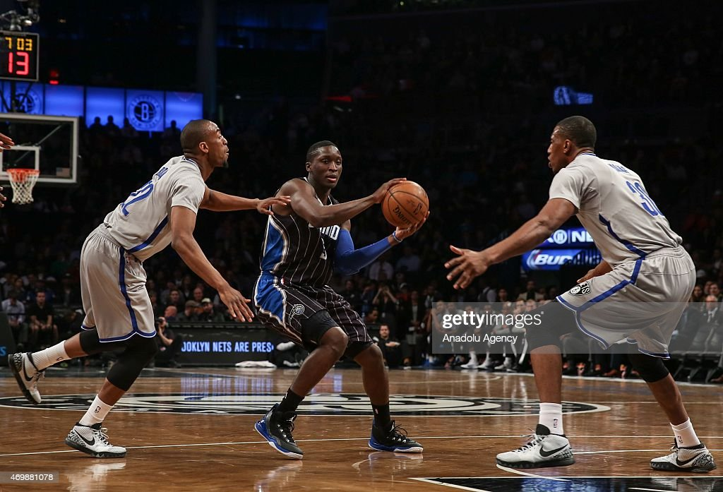 Victor Oladipo (5) of the Orlando Magic in action against Markel Brown (22) and Thaddeus Young (30) of the Brooklyn Nets during an NBA basketball game at the Barclays Center in the Brooklyn borough of New York City on April 15, 2015.